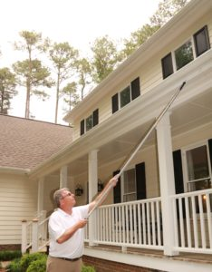 Tim Wiggins using one of the tools to inspect a house
